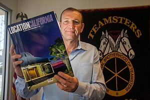 Steve Dayan with the California Film Commission's Location California magazine at his North Hollywood office.