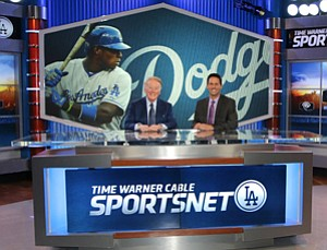 Vin Scully, left, and John Hartung at SportsNet LA's El Segundo studio.