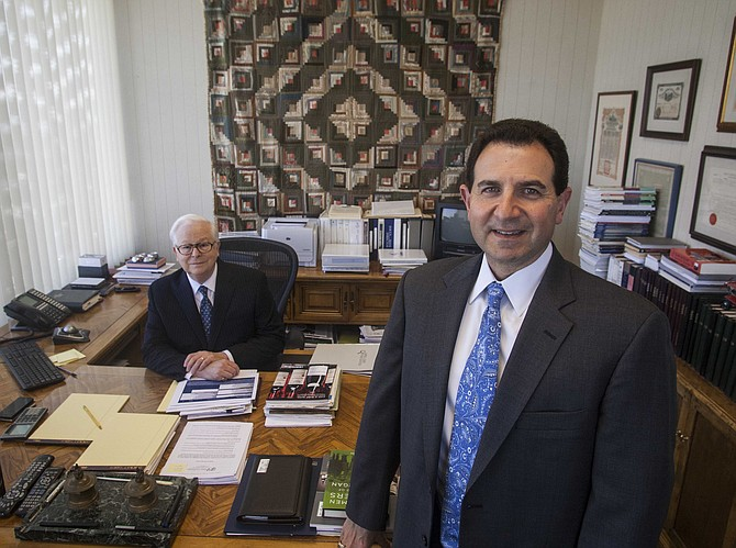 Joel Ravitz, left, with new CEO Mark Minichiello, at  Quincy Cass Associates in West Los Angeles.