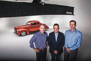 Scott Dickey, left, Chris Argentieri, and Bill Sutman at Source Interlink's office in El Segundo.
