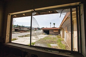 Abandoned buildings at former naval property will be razed.