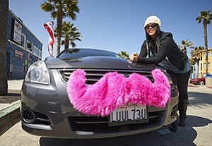 Christina Murphy is among the growing number of independent drivers who have put pink mustaches on their cars to signify that they work for the ride-sharing company Lyft Inc.