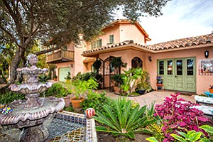 The house pictured above is listed by Shawn Couch of The Certified Group at 1183 Saxony Road in Encinitas. It is a 3,650-square-foot, three bedroom, four and a half bath home on 0.42 acres listed at $2.2 million.