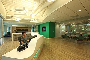 CBRE Group Inc.'s nearly paperless offices have a concierge desk to facilitate communication, along with an array of collaborative meeting spaces, including cafes and conference rooms.