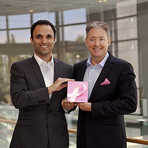 CEO Jim Plant, left, and Chief Strategy Officer Ardy Arianpour of Pathway Genomics Corp. with the company's BRCA test kit.