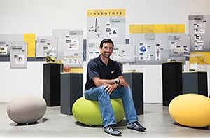 John Sarkisian, CEO of SKLZ, sits in front of the company's inventors' wall, which recognizes independent inventors whose designs have led to products that the company sells.