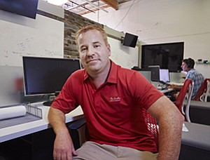 Chad Buckmaster, CEO of Carlsbad-based Processing Point, said one of his goals in redesigning workspace was to tear down the walls that separated hardware staff from software staff.