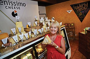 Gina Freize, co-founder of Venissimo Cheese Inc., is among the few specialty food purveyors who are part of Amazon.com Inc.'s initial rollout of the AmazonFresh delivery service in San Diego.
