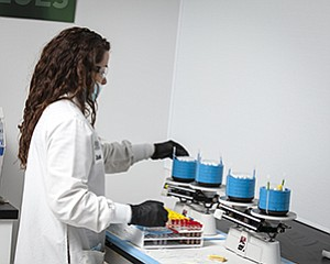 A Millennium laboratory worker processes samples for health care professionals to evaluate.
