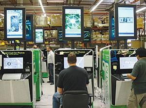 Technicians review ecoATM kiosks on D&K Engineering's testing line in Rancho Bernardo.
