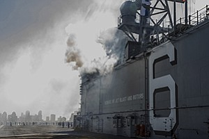 The USS America fires a saluting battery on Sept. 15 as it arrives for the first time in San Diego.