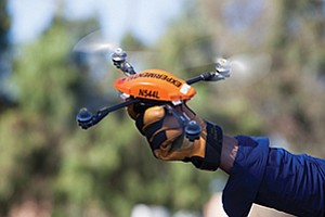 SDG&E is testing the orange quad-copter drone for use in inspecting wires and other company infrastructure. The use of drones could be a money-saver for the utility.
