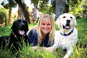 Karen Scoggins and her husband have turned their work-around solution for dining out with their dogs, Knight and Boomer-Buckaroo, into a growing business.