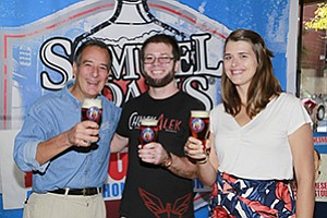 Jim Koch (left), founder and chairman of Boston Beer Co., maker of Samuel Adams beers, shares a beer with  ChuckAlek founders Grant Fraley and Marta Jankowska. The Ramona brewers' company was chosen by Boston Beer to receive a $10,000 microloan and a mentorship.