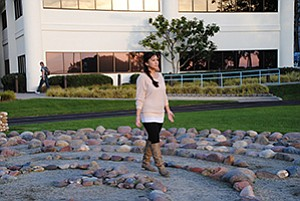 Darlene Carreon, 31, walks the labyrinth as a form of meditation at the Scripps Center for Integrative Medicine, where she also practices yoga.