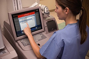 A nurse reviews a patient's information using CareFusion's Pyxis Advisor system, one of many of the company's products subject to the medical device tax.