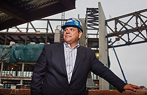 Rene Olivo, VP of San Diego operations for Rudolph and Sletten Inc., stands in front of the Altman Clinical and Translational Research Institute being built at the UC San Diego medical campus.