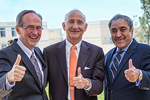 Robert Sullivan, dean of the Rady School of Management at the University of California, San Diego, philanthropist Ernest Rady and Pradeep Khosla, chancellor of UC San Diego, celebrate the formal announcement of Rady's $100 million gift to the business school.