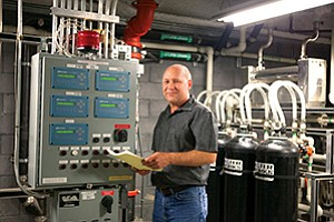 Maintenance Manager John M. Reed has been working to reduce Sanford-Burnham's water consumption for the past 10 years, using recycled water for irrigation and cooling, repurposed wastewater from filtration machines, and replacing tropical plants with drought-resistant landscaping.