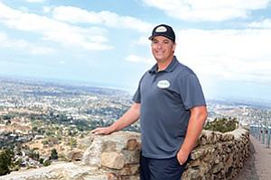 Gabriel Carini, a longtime resident of La Mesa, enjoys a moment atop Mount Helix.