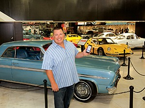 Troy Mack, shown here at the San Diego Automotive Museum at Balboa Park, is trying to disrupt the auto sales market with a digital platform that gives dealers greater control of their inventory.