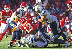 A typical NFL play involves several collisions. The NFL is teaming up with companies and others to find ways to detect when those impacts lead to traumatic brain injury.
