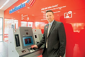 Bank of America's video ATMs allow customers to access accounts without their debit cards, make loan payments and cash checks. The bank's Point Loma branch, managed by Kevin Winchester, is one of three in the county with the new ATMs.