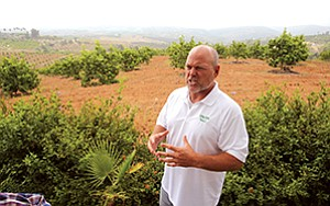 Developer R. Randy Goodson, CEO of Accretive Investments Inc., stands on the site of a North County property where he hopes to build Lilac Hills Ranch, a mixed-use, 608-acre community.