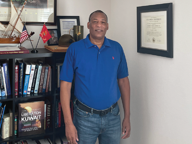Clement Johnson in his office at ClemTech LLC. The bookcase behind him includes memorabilia from his 24 years in the U.S. Marine Corps. Photo courtesy of ClemTech LLC