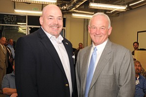 Turner Construction executive Shawn Rosenberger, left, meets with Mayor Jerry Sanders. The mayor says Turner's school of construction management will give more businesses the opportunity to compete for city contracts.