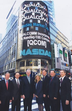Qualcomm executives mark the corporation's appearance on the Nasdaq in this photo from the company archives.
