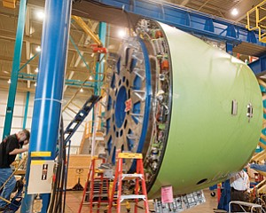 A thrust reverser, part of the nacelle, is worked on at Goodrich Aerostructures. This one is for the Airbus A350 XWB.