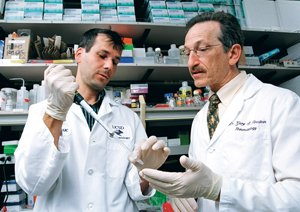 Gary Firestein, dean and associate vice chancellor of Translational Medicine at the UCSD School of Medicine, right, works with colleague Jean-Marc Waldburger. Firestein says public-private partnerships are important in a time of decreasing federal grant support.