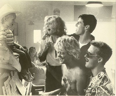 Tom Cruise, Kelly McGillis and others sing during a scene from 'Top Gun' shot at Kansas City Barbeque in San Diego. Legend3D Inc. is converting the movie to a 3-D format, sources say.