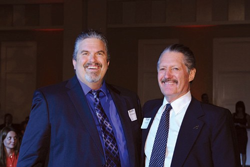 Frank Arrington, right, was honored by his now adult 'little brother' Scott Erickson, at a Big Brothers Big Sisters dinner.