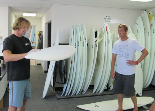 "Rouven ""Bufo"" Brauers examines a surfboard. Brauers' company Hydroflex is work on ways to improve the technology of surfing."