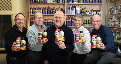 From left, WD-40 Co. executives Jay Rembolt, Peter Dumiak, Garry Ridge, Timothy Lesmeister and Graham Milner hold one of the company's earliest and most recent cans of WD-40. WD-40 Co., Qualcomm, Jazzercise and Jack in the Box are among the county's most successful startups.
