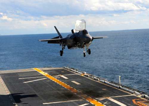 One F-35B test aircraft follows another for a vertical landing on the USS Wasp during sea trials. A Marine Corps general calls the F-35B 'the single most important program in the Marine Corps today.'