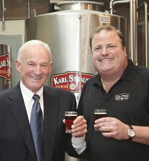 The local craft beer industry has grown significantly since Chris Cramer, right, helped launch Karl Strauss, one of the county's first craft breweries, in 1989. Cramer is shown with Mayor Jerry Sanders, who says the industry is helping put people back to work.