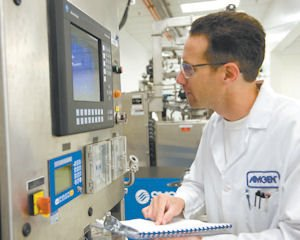 Research: Amgen employee examines data in lab at company's headquarters in Thousand Oaks.