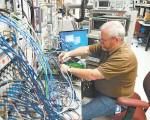 Wires: Mike Johnston working in the lab at Vitesse Semiconductor Corp. in Camarillo.