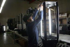 Employee at Phototron's Gardena factory.