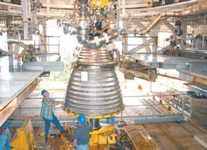 Caption: A J-2X engine built in Canoga Park is fitted into a test stand at Stennis Space Center.