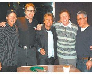 Song: Davy Jones (center) in recording studio with Steve Syatt (far right).