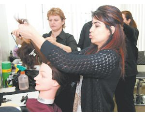 Lessons: Janet Torosiyan practices hair styling technique on a mannequin at the International College of Beauty, Arts and Sciences in Glendale.