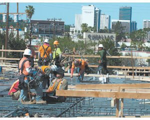 Build: Workers in a field of rebar on the roof of a BW Brody construction project.