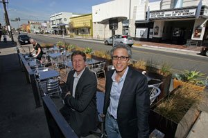 Michael Bohn, left, and Alan Pullman at a Long Beach 'parklet' their company designed.