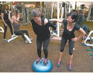 Bounce: Trainer Judy Fink(right) trains Danielle Roberts on the bosu ball at Total Woman Gym & Day Spa in Woodland Hills.