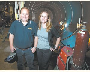 Team: Dave Mason (left) and Gudrun Mason stand beside an autoclave being built at the ASC Process System's factory in Valencia.