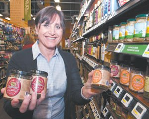 Cook: Lorena Stephenson holds jars of her cooking base atWhole Foods Market in Tarzana, one retailer selling the product.
